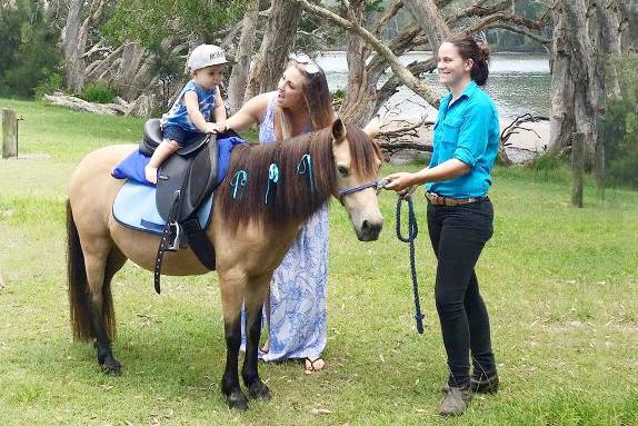Baby Riding A Pony