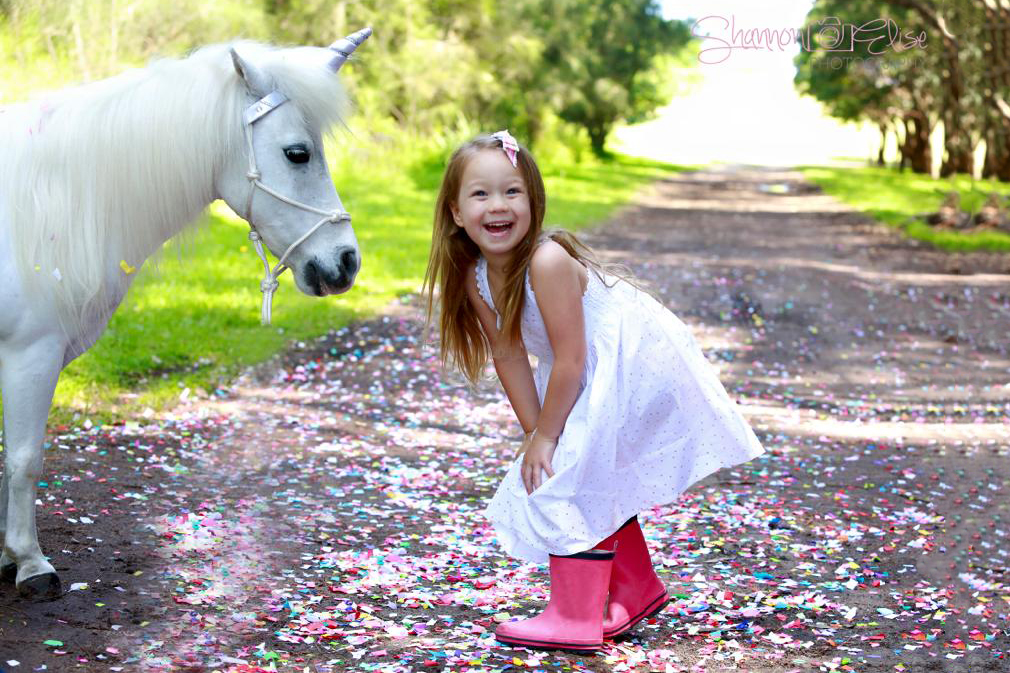 Girl Laughing With Pony