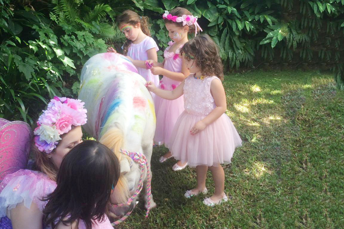 Pony Being Painted By The Children At A Party