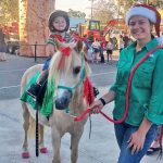 Boy Riding Christmas Pony