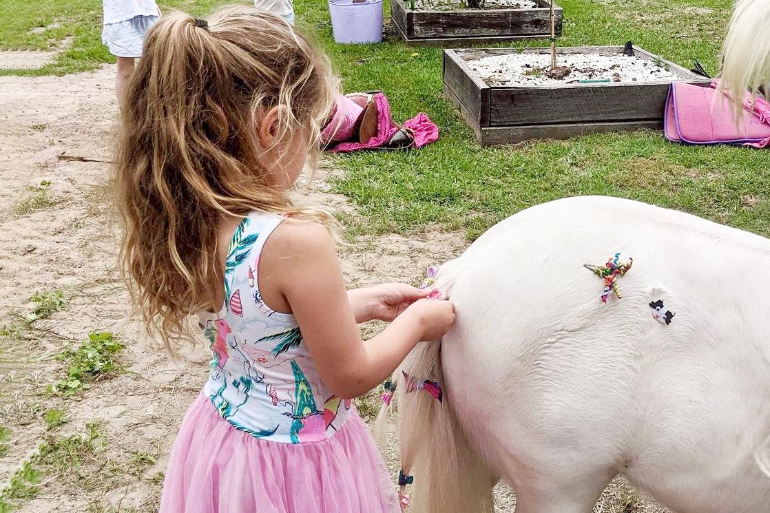 Girls Braiding Pony's Tail