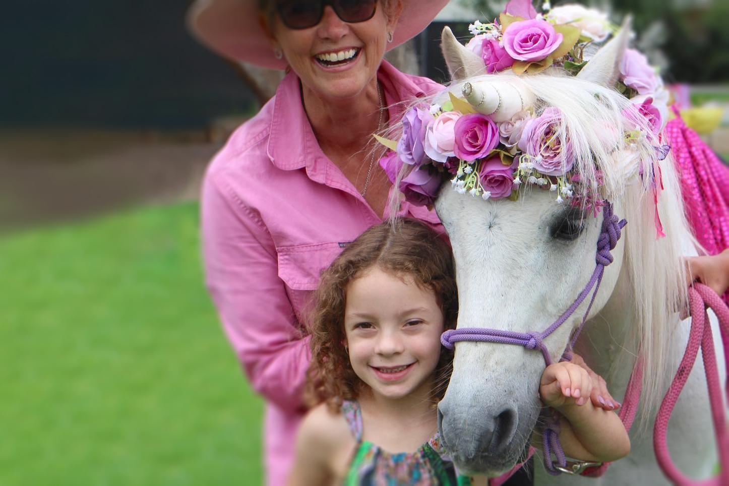 Happy People With Flower Pony