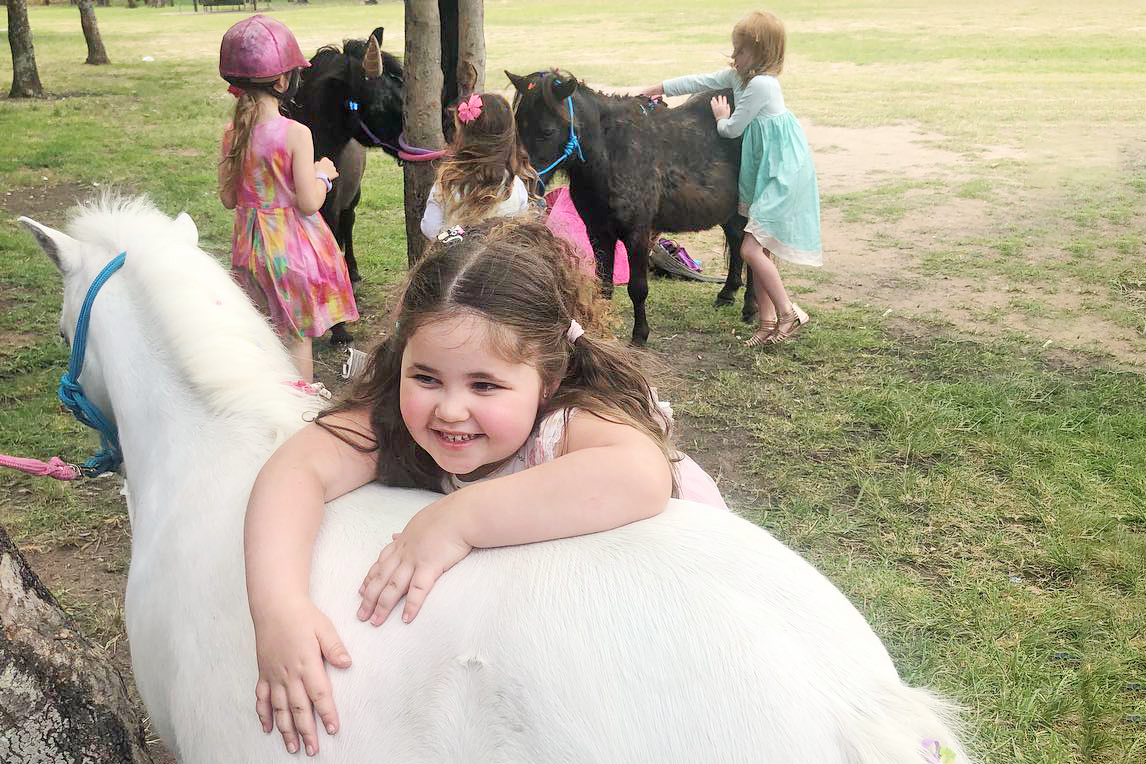Small Girl Leaning On Pony